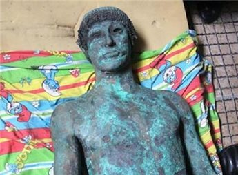 A picture taken in Gaza on Sept. 19, 2013 shows a 2,500-year-old bronze statue of the Greek god Apollo discovered by Palestinian fishermen in August (Gaza's Ministry of Tourism/AFP)