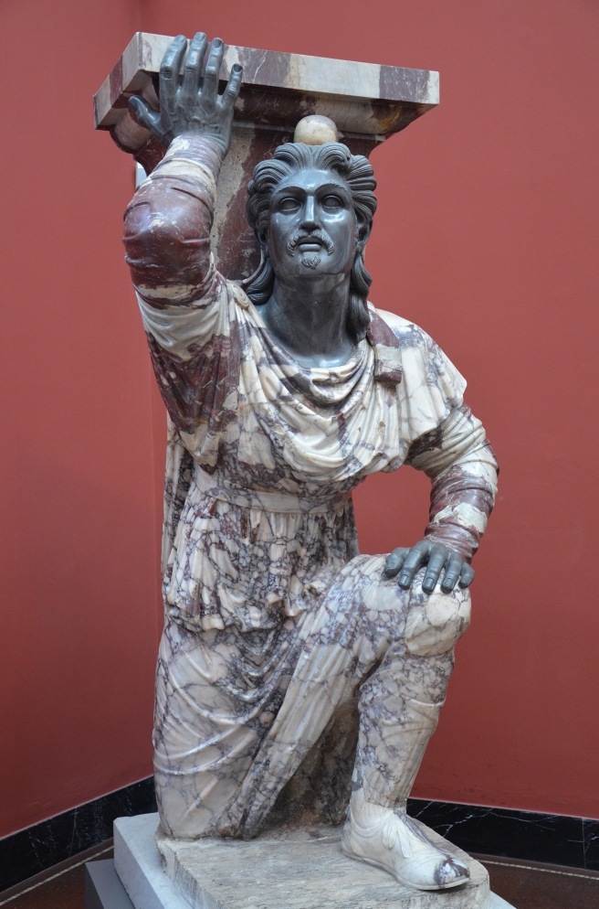 Kneeling_Barbarian_with_coloured_trousers_and_Phrygian_cap,_from_Rome,_ca._20_BC,_Pavonazzetto_marble_from_Asia_Minor,_Ny_Carlsberg_Glyptotek,_Copenhagen_(23502345672)